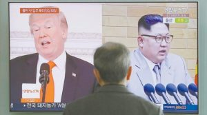A MAN WATCHES a TV screen showing file images of U.S. President Donald Trump, left, and North Korean leader Kim Jong Un, right, during a news program at the Seoul Railway Station in Seoul, South Korea Tuesday.