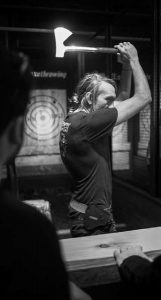 """AN """"AXEPERT"""" gives contestants instruction on hatchet throwing techniques and the rules of the game at the Kick Axe Throwing venue in the Brooklyn borough of New York."""