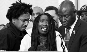 Sequita Thompson, center, discusses the shooting of her grandson, Stephon Clark, during a news conference Monday in Sacramento, Calif. Thompson was accompanied by Clark's uncle, Kurtis Gordon, left, and attorney Ben Crump, right.