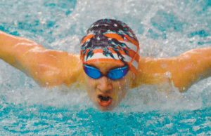 CALEB WILLIAMS of Long Reach Swim Club swims in the 13-and-over 100-yard butterfly event in the Maine Junnior Olympics recently held at Greason Pool at Bowdoin College in Brunswick.