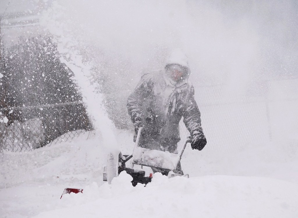 Kyle Binette is surrounded by wind-driven snow as he snow cleared his driveway in Biddeford last March.