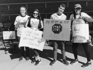 MT. ARARAT HIGH SCHOOL INTERACT CLUB MEMBERS raised more than $1,680 Saturday during its annual Cram the Van food drive for the Midcoast Hunger Prevention Program, held this year at Shaw's Supermarket in Brunswick.