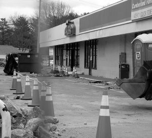 THE BUILDING at 190 Bath Road in Brunswick, housing Cumberland Farms, Papa John's Pizza and and AT&T retail shop is being demolished to make way for a new stand-alone Cumberland Farms. The new retail store will have fuel service with 10 fueling locations and an associated canopy. The plan called for site improvements including a reconfigured parking area, bike rack, modified entrance driveways and a new trash enclosure. The Brunswick Planning Board approved the redevelopment project in 2016. DARCIE MOORE / THE TIMES RECORD