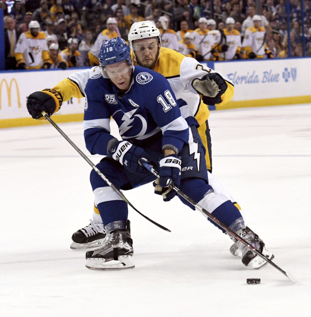 Ondrej Palat of the Tampa Bay Lightning tries to get away from Nashville defenseman Anthony Bitetto during the Predators' 4-1 win Sunday night.