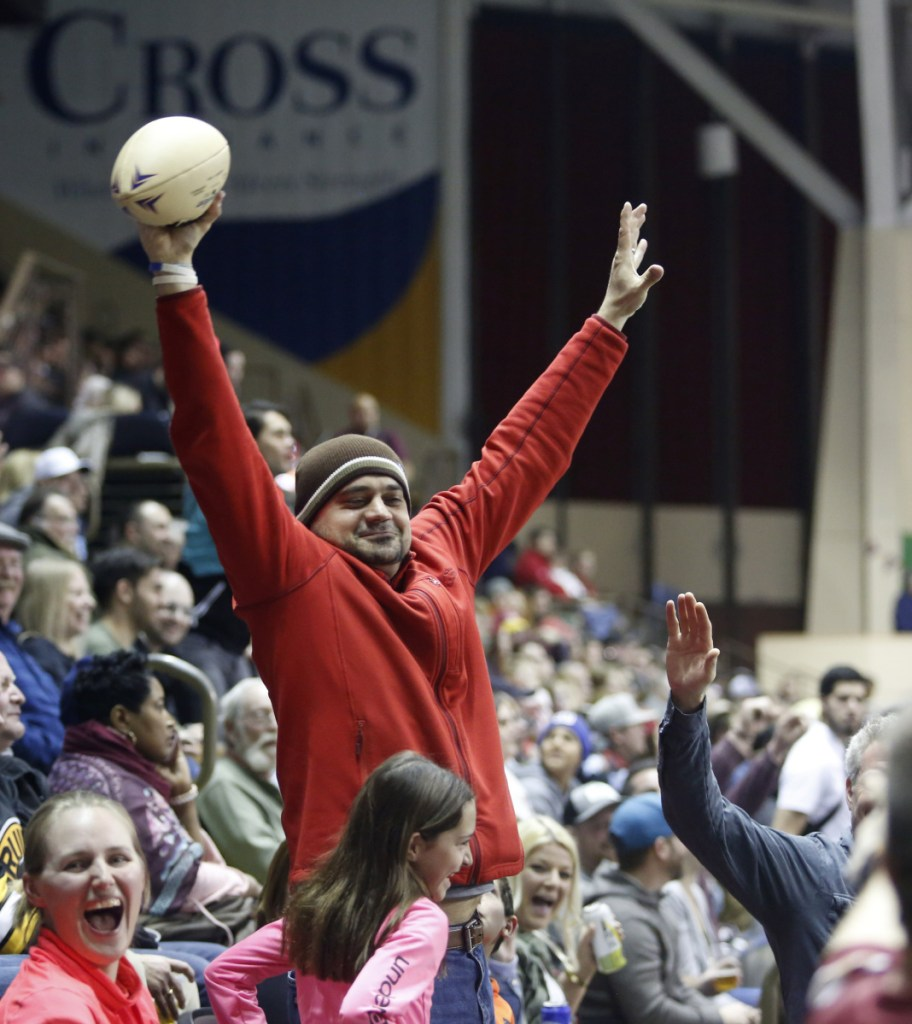 Angelo Salvaggio of Portland celebrates hauling in a game ball that went into the stands during the Mammoths' game against Carolina. Fans are allowed to keep balls that enter the stands.