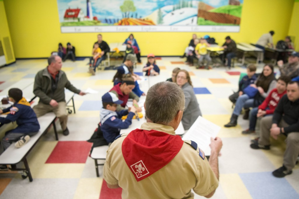 Willie LeHay reads announcements about up coming trips during a Kennebec County Cub Scout pack meeting at Williams Elementary School in Oakland on Tuesday.