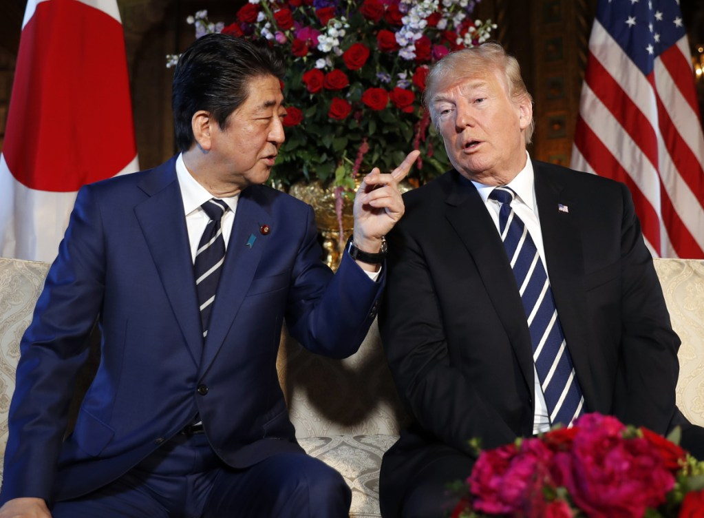 President Trump and Japanese Prime Minister Shinzo Abe speak during a meeting at Trump's private Mar-a-Lago club on Tuesday in Palm Beach, Fla.