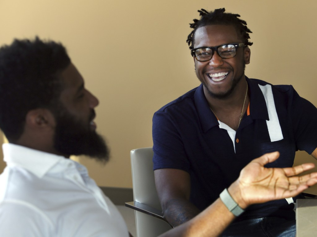 Rashon Nelson, left, and Donte Robinson, laugh during an interview in Philadelphia Wednesday.