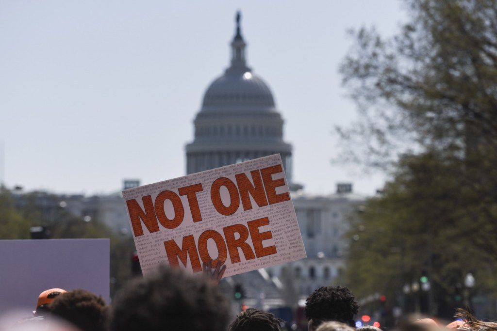 Hundreds of students march down Pennsylvania Avenue on Friday as part of a school walkout protesting gun violence. The demonstration came on the 19th anniversary of the Columbine, Colorado, high school  massacre.