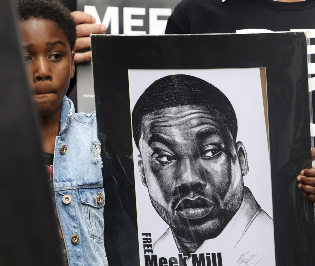 Papi Mills, the son of rapper Meek Mills, holds a poster last week during a protest calling for his father's release from prison while he appeals decade-old gun and drug convictions.