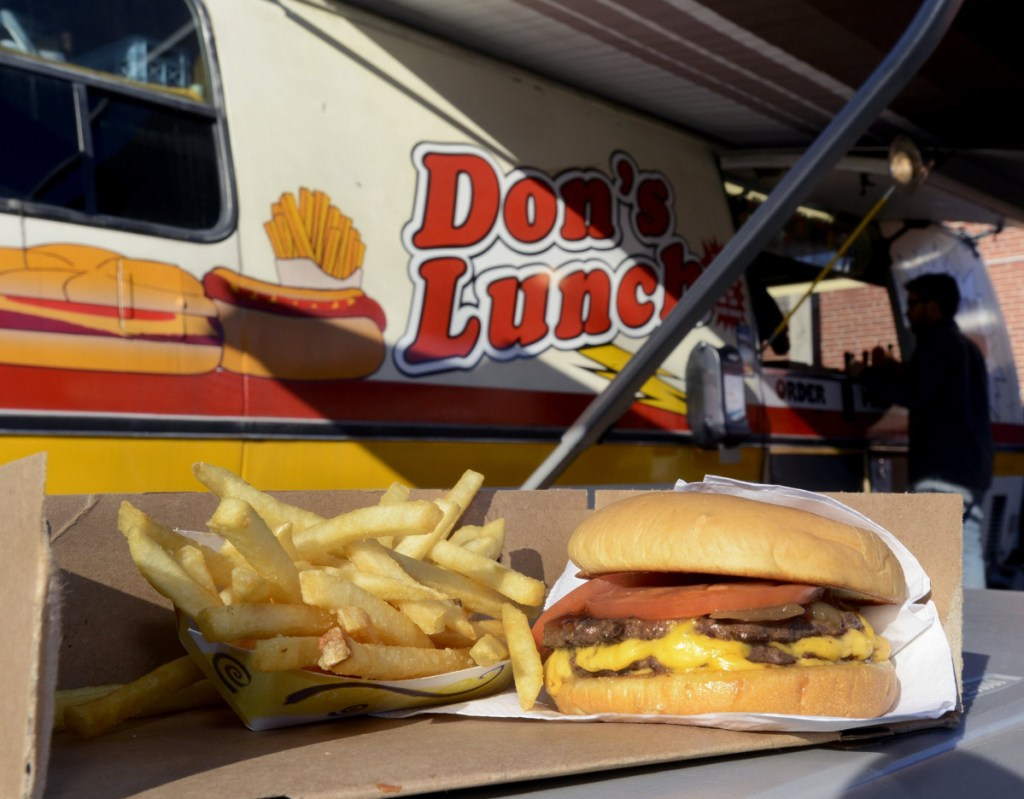 """Double cheeseburger called the """"Big One"""" and french fries served at Don's Lunch Van on Main Street in Westbrook."""