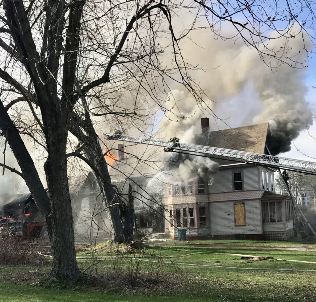 A fire burns the three-story building at 10 West St. in Gardiner on Monday afternoon.