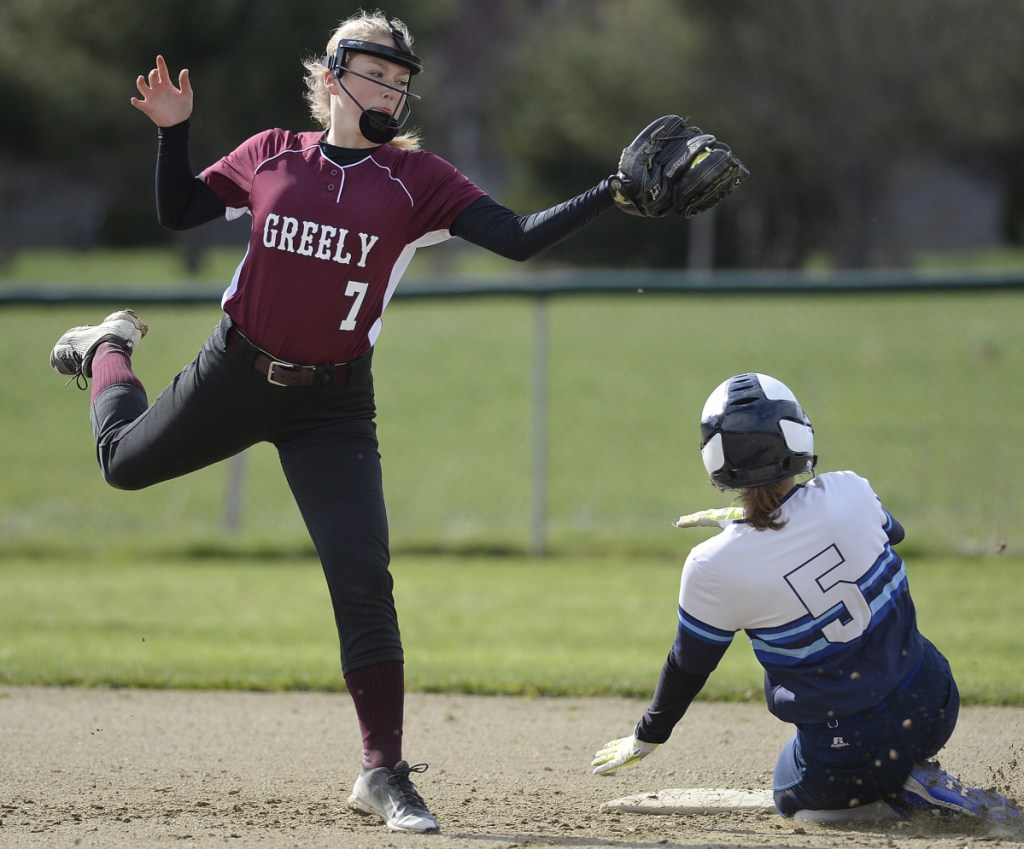 Sawyer Dusch of Greely attempts to put the tag on Lexi York, who stole second base for York, which put the game away with a four-run seventh inning.