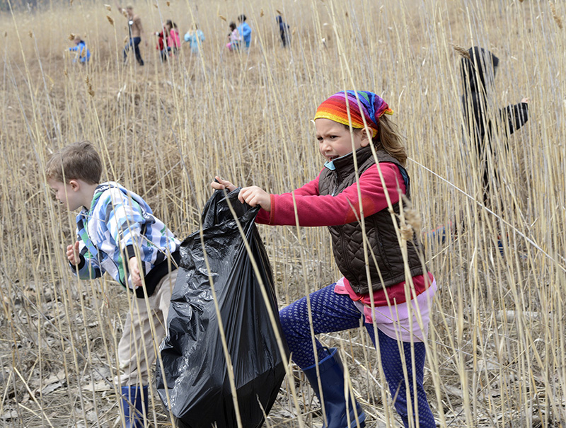 Maine Audubon's April vacation camp in Falmouth to celebrate Earth Day that includes picking up trash along the marsh. Declan Rowles, 6 yrs. and Talia Olins, 7yrs. take part in 2014.
