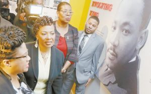 REV. BERNICE KING, second from left, daughter of the late civil rights leader Rev. Martin Luther King Jr., tours an exhibit at the National Civil Rights Museum Monday in Memphis, Tenn. The museum was formerly the Lorraine Motel, where Rev. Martin Luther King Jr. was assassinated April 4, 1968.