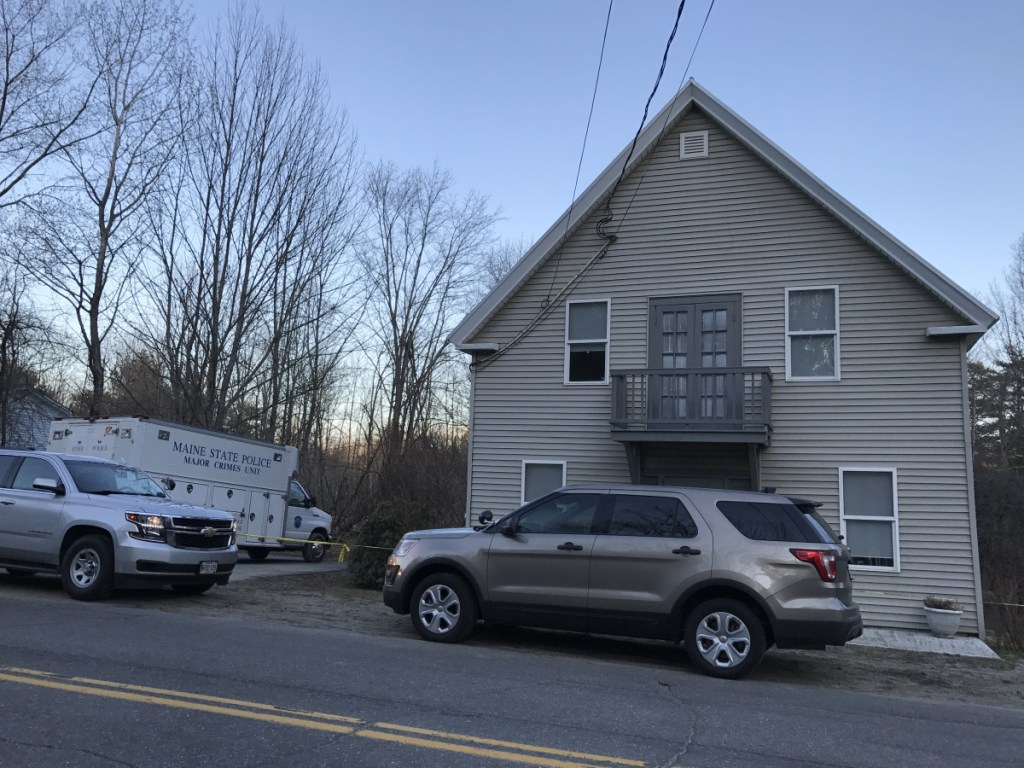 The Maine State Police Major Crimes Unit truck is parked outside of 1482 Hallowell Road in Litchfield on Sunday.