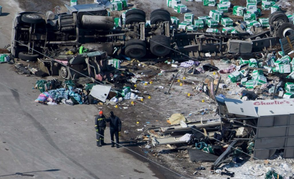 The wreckage of a fatal crash outside of Tisdale, Saskatchewan, is seen Saturday. A bus carrying the Humboldt Broncos hockey team crashed with a truck en route to Nipawin for a game Friday night.
