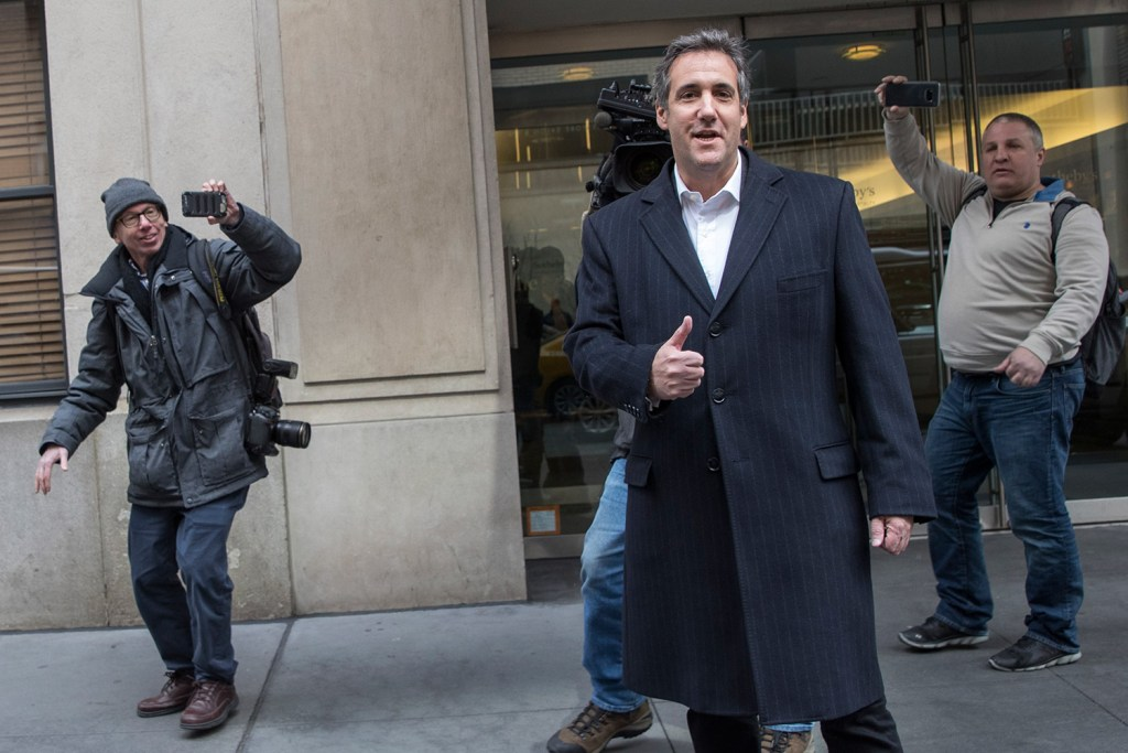 "Attorney Michael Cohen gives photographers the thumbs up as he walks in New York on Wednesday. Federal prosecutors say in a court filing Friday that the criminal probe that led them to raid Cohen's offices is focused on his ""personal business dealings."""