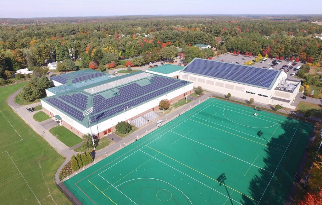 Rooftop solar panels are shown on Bowdoin College's Sidney J. Watson Ice Arena and Farley Field House in a photo shot by a drone in 2015. The college announced Thursday that it is now carbon neutral.