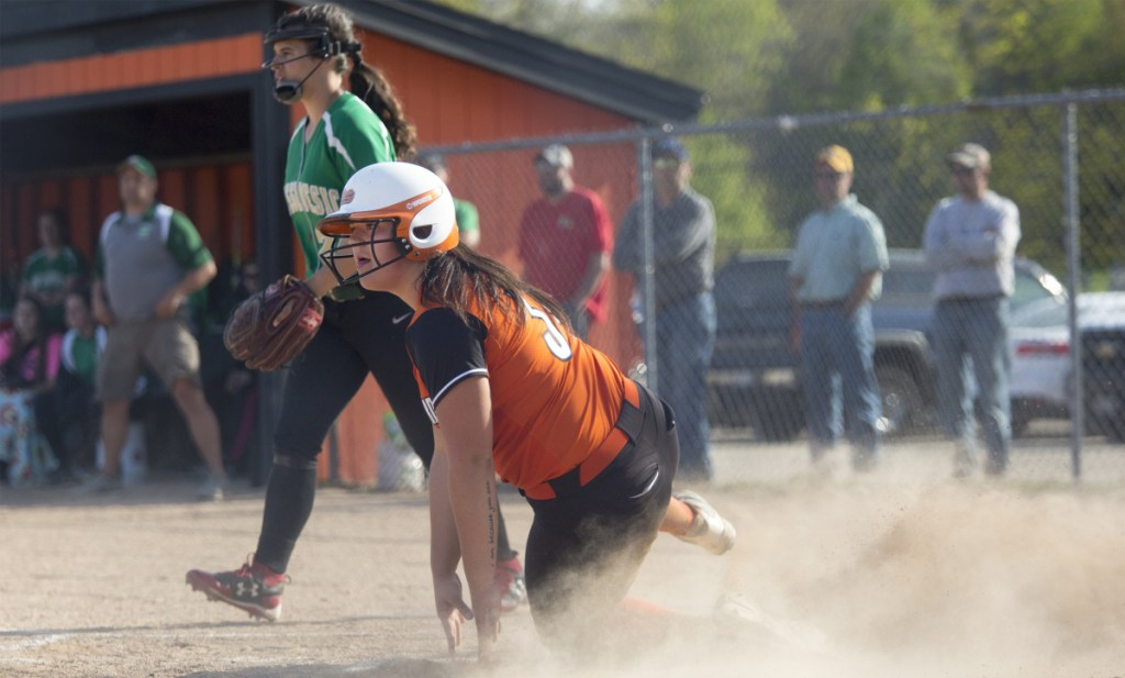 Brook Davis of Biddeford slides safely into the plate Friday during the SMAA softball game against Massabesic at Biddeford. Massabesic improved its record to 9-3 by coming away with a 17-4 victory.