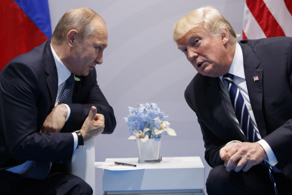 President Trump meets with Russian President Vladimir Putin at the G20 Summit on July 7, 2017, in Hamburg, Germany. The Senate Intelligence Committee has concluded that Russia meddled in the 2016 election with the intention of helping Trump, a finding that runs counter to what House Republicans say.