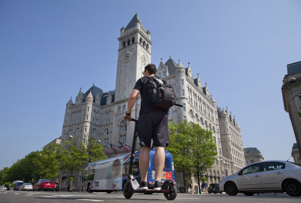 A man rides a Bird electric scooter along Pennsylvania Avenue in front of the Trump International Hotel in downtown Washington earlier this month.