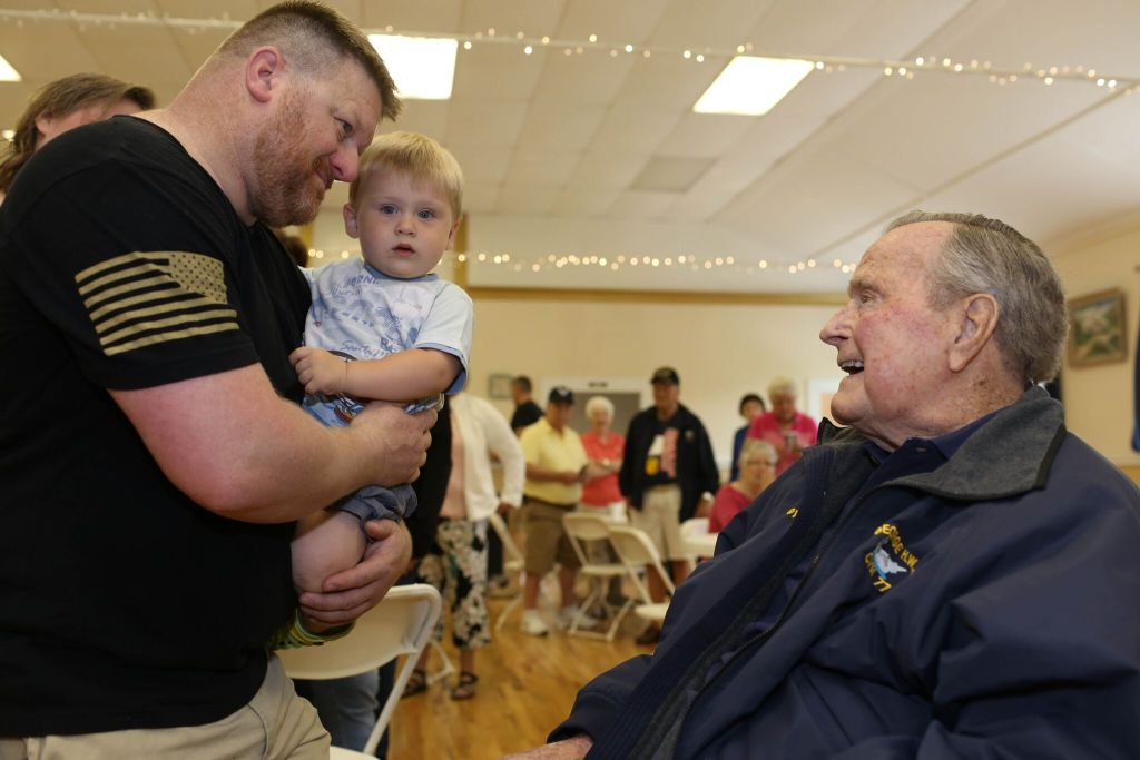 George H.W. Bush greets attendees at the pancake breakfast.