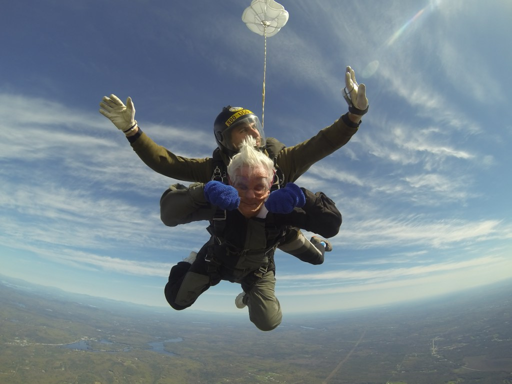 Dorothea Labrie, 86, of Lewiston goes sky diving with instructor Brian Boyle on Sunday.