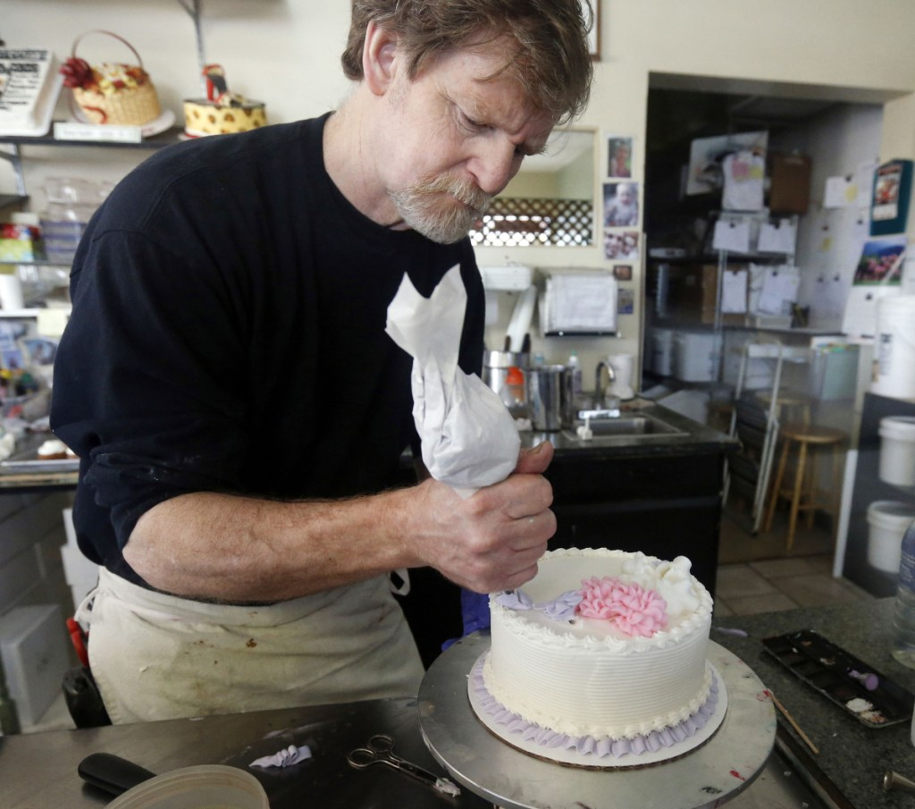 The Supreme Court on Monday set aside a Colorado court ruling against Jack Phillips, above in 2014, a baker who wouldn't make a wedding cake for a same-sex couple. But the court is not deciding the big issue in the case: whether a business can refuse to serve gay and lesbian people.