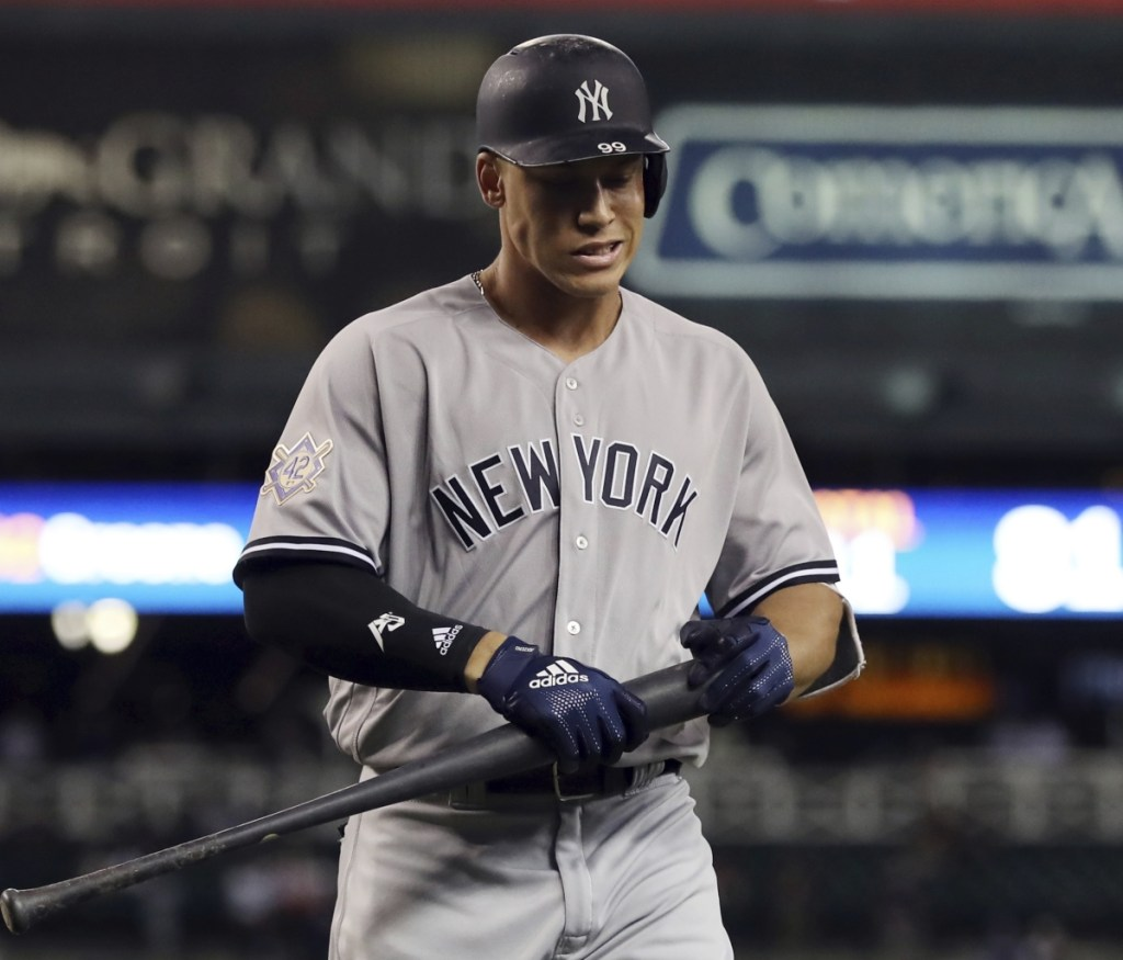 Aaron Judge of the Yankees walks back to the dugout after striking out in the ninth inning for the fifth time in the second game of a doubleheader against Detroit Monday. Judge struck out eight times in the two games,