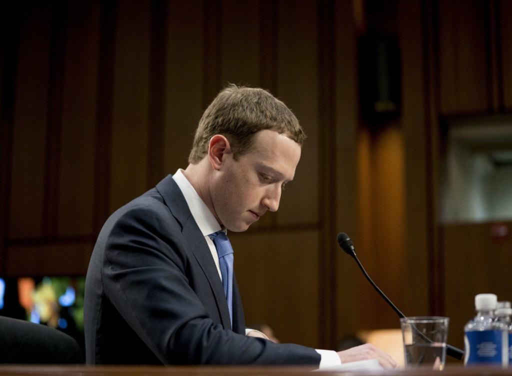 Facebook CEO Mark Zuckerberg testifies before a joint hearing of the Commerce and Judiciary committees in April. Lawmakers asked Zuckerberg in a letter Tuesday if he now wanted to amend his April testimony.