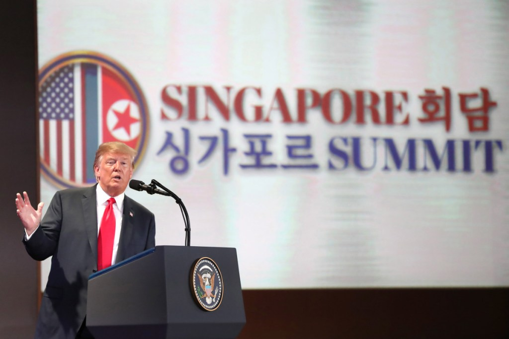 "President Trump speaks during a news conference in Singapore on Tuesday. He later tweeted that the ""deal"" he struck with North Korean leader Kim Jong Un meant there was ""no longer a Nuclear Threat from North Korea,"" and ""everybody can now feel much safer."""