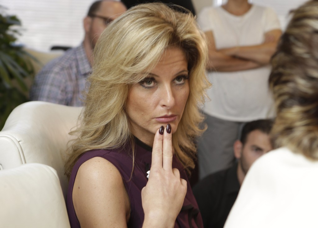 """Summer Zervos, who appeared on the reality show """"The Apprentice,"""" said that Trump kissed her on the lips several times in 2007."""