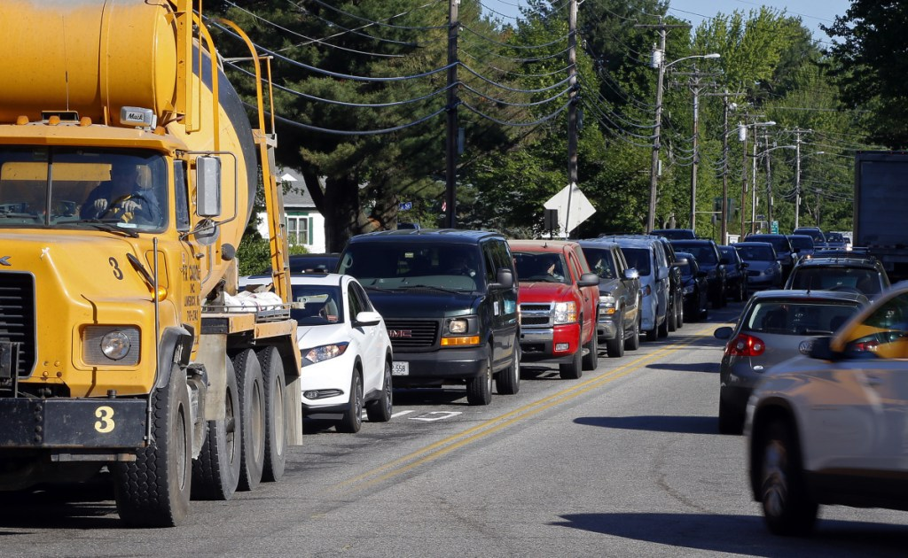 Traffic backs up Friday at the intersection of Industrial Park Road and Route 112 in Saco. Nearly 20,000 cars travel through the corridor each day on average, including more than 18,000 that use Industrial Park Road, according to the Maine Department of Transportation.