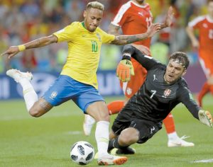 BRAZIL'S Neymar (left), attempts to shoot past Serbia goalkeeper Vladimir Stojkovic during the Group F match between Serbia and Brazil at the 2018 soccer World Cup in the Spartak Stadium in Moscow, Russia on Wednesday. THE ASSOCIATED PRESS