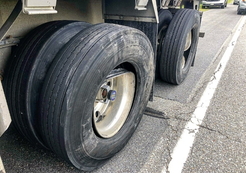The wheels of a tractor-trailer on the side of Skowhegan Road in Fairfield appear damaged Friday morning. The tractor-trailer was involved in a collision with a 2002 Buick LeSabre that sent one person to the hospital with injuries that police did not believe were life threatening.