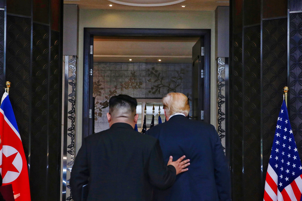 President Trump and North Korean leader Kim Jong Un leave a post-summit signing ceremony in June. The Trump administration sent mixed signals by announcing new sanctions against North Korea on Thursday, only to have Trump tweet Friday that he was canceling the move by the Treasury Department.