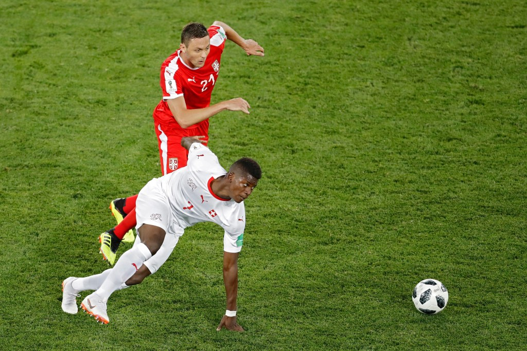 Serbia's Nemanja Matic, top, vies for the ball with Switzerland's Breel Embolo during the group E match between Switzerland and Serbia at the 2018 soccer World Cup in the Kaliningrad Stadium in Kaliningrad, Russia.