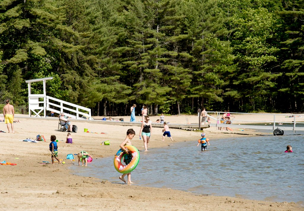 Children play on the beach at Range Pond State Park in Poland on Tuesday afternoon. A 13-year-old Lewiston student on a school field trip drowned there in the morning.