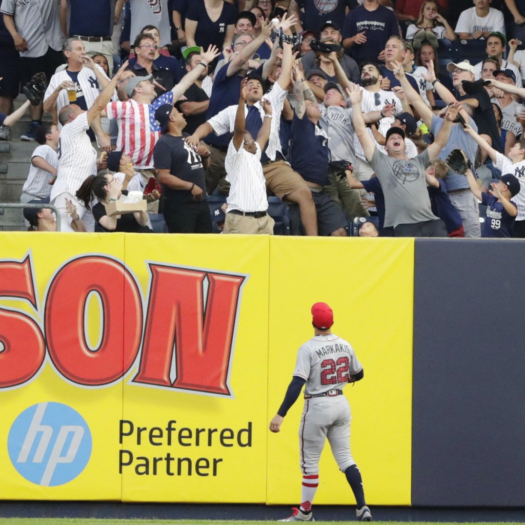 Braves right fielder Nick Markakis watches a two-run home run by New York's Aaron Hicks in the first inning Tuesday night in New York. The Yankees held on for an 8-5 win.