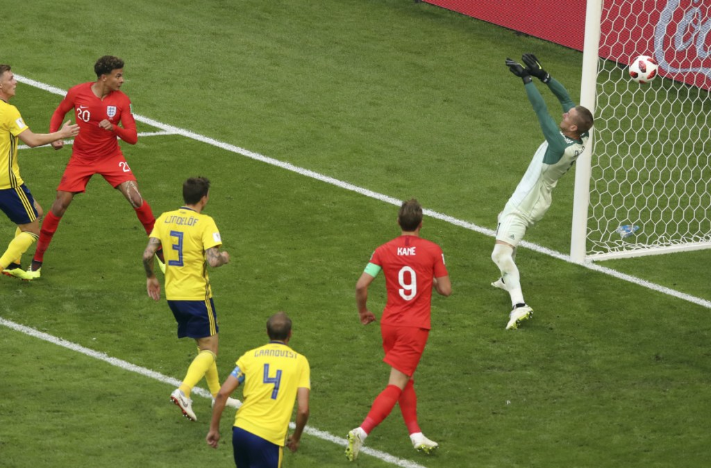 England's Dele Alli, second from the left, scores his side's second goal during the quarterfinal match between Sweden and England at the 2018 World Cup in Samara, Russia on Saturday. England will face Croatia in the semifinals Wednesday.