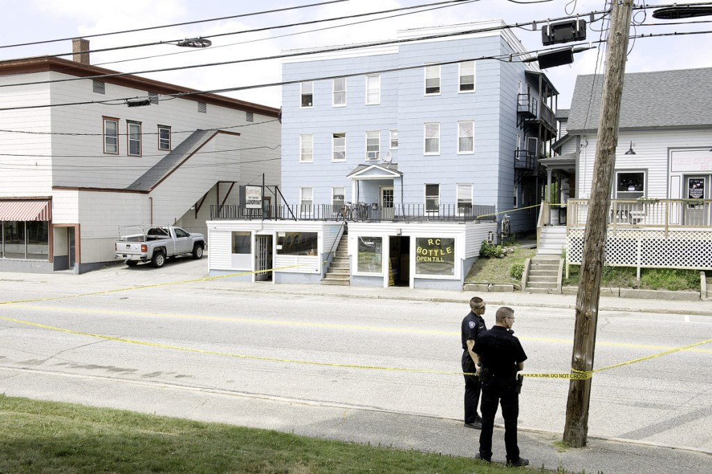 Lewiston police officers Sunday morning closed Sabattus Street, between Oak and College streets, while investigating a stabbing outside Rancourt's Laundromat. (Daryn Slover/Sun Journal)