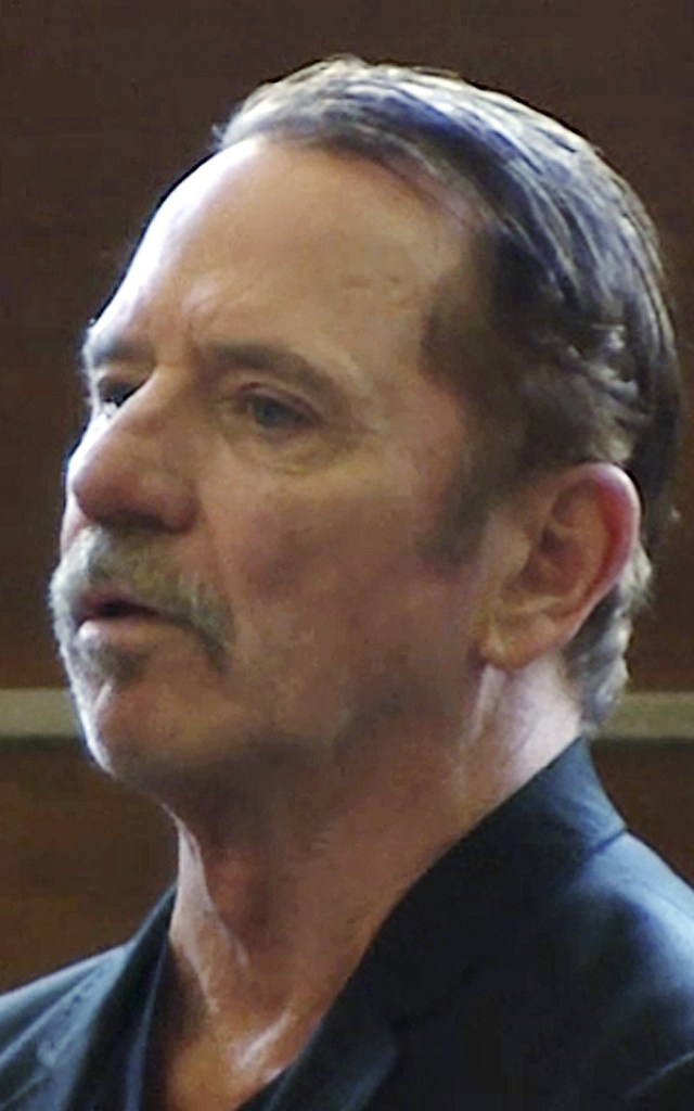 "TOM WOPAT this Aug. 3, 2017 file frame from video, actor Tom Wopat stands during arraignment in Waltham, Mass., on indecent assault and battery and drug possession charges. The former star of ""The Dukes of Hazzard"" television show pleaded guilty to inappropriately touching two women in the cast of a musical in Massachusetts in which he starred. Prosecutors said Wopat was sentenced Friday, July 20, 2018, to a year of probation. (WCVB-TV via AP, Pool, File)"