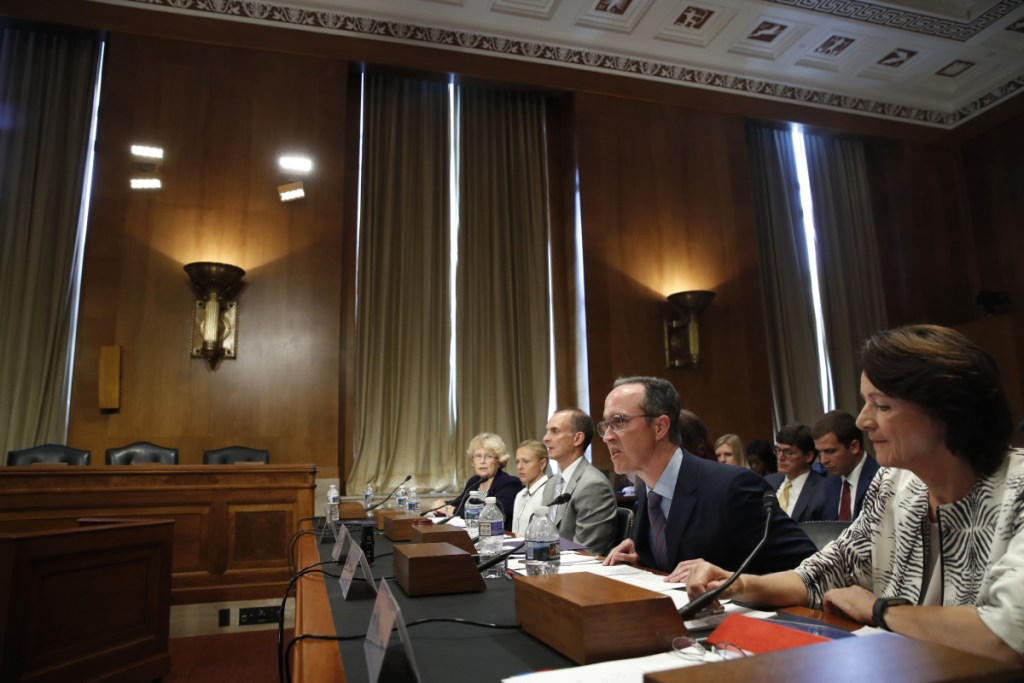 Jim Walden, second from right, the attorney for a Russian lab director who exposed cheating at the Sochi Olympics, testifies at a hearing on the impact of doping in international sport on Wednesday on Capitol Hill in Washington.