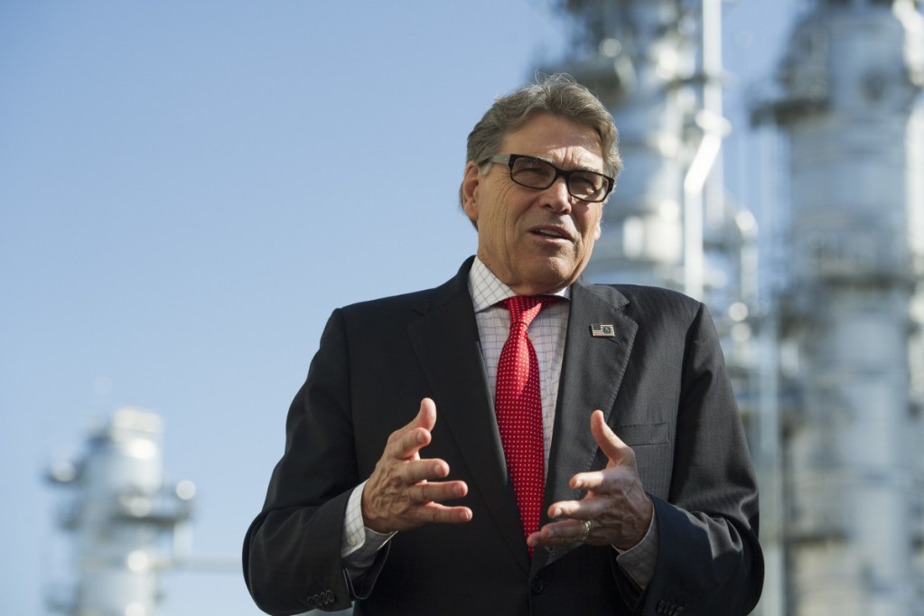 Secretary of Energy Rick Perry stands with the main cyrogenic heat exchange as he speaks with reporters at Dominion Energy's Cove Point LNG liquefaction Project facility in Lusby, Md., Thursday, July 26, 2018. The completion of the facilities export expansion project makes it just the second LNG export facility in the U.S. Associated Press/Cliff Owen