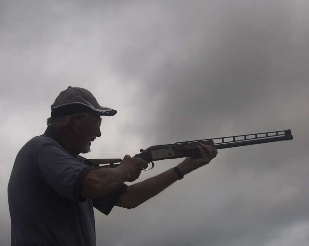 Cal Stinson Jr., a 90-year-old champion trap shooter, competes in the 128th annual Maine State Trapshooting Championship at the Scarborough Fish and Game Association. Stinson has been shooting since 1947.