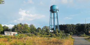 THE WATER TOWER has been unused since at least 1992, when the Navy shut down its fuel depot operations at Mitchell Field in west Harpswell. When the town took possession of the site from the Navy in 2001, it came with the water tower — originally installed in the 1950s — and a pier that is now being demolished. NATHAN STROUT / THE TIMES RECORD
