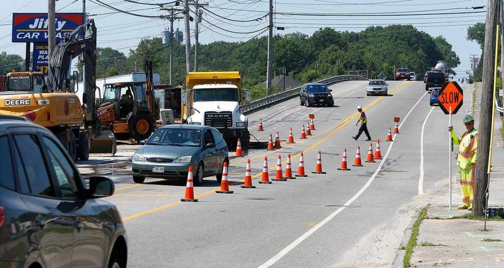 Traffic is flowing, though a little more slowly, in both lanes of Main Street/Route 1 in South Portland Thursday as repairs to a broken water continue.