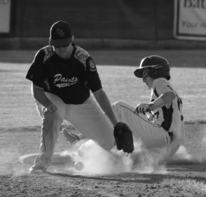 FREEPORT'S Nick Signovelli slides safely into third base as GNG's Nick McCann blocks the throw. ERIC MAXIM / TIMES RECORD STAFF