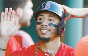 BOSTON RED SOX Mookie Betts celebrates after scoring on a single by Brock Holt during the second inning of a baseball game against the Toronto Blue Jays in Boston on Friday. THE ASSOCIATED PRESS